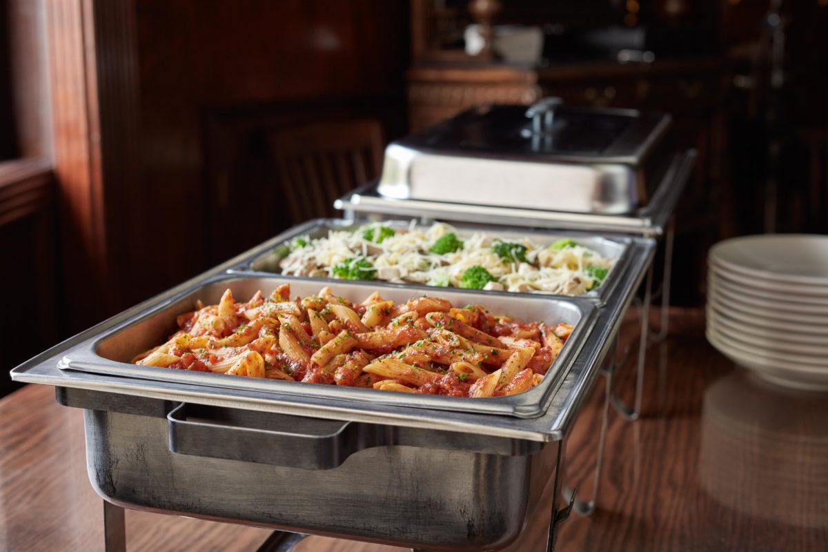 catering trays filled with pasta