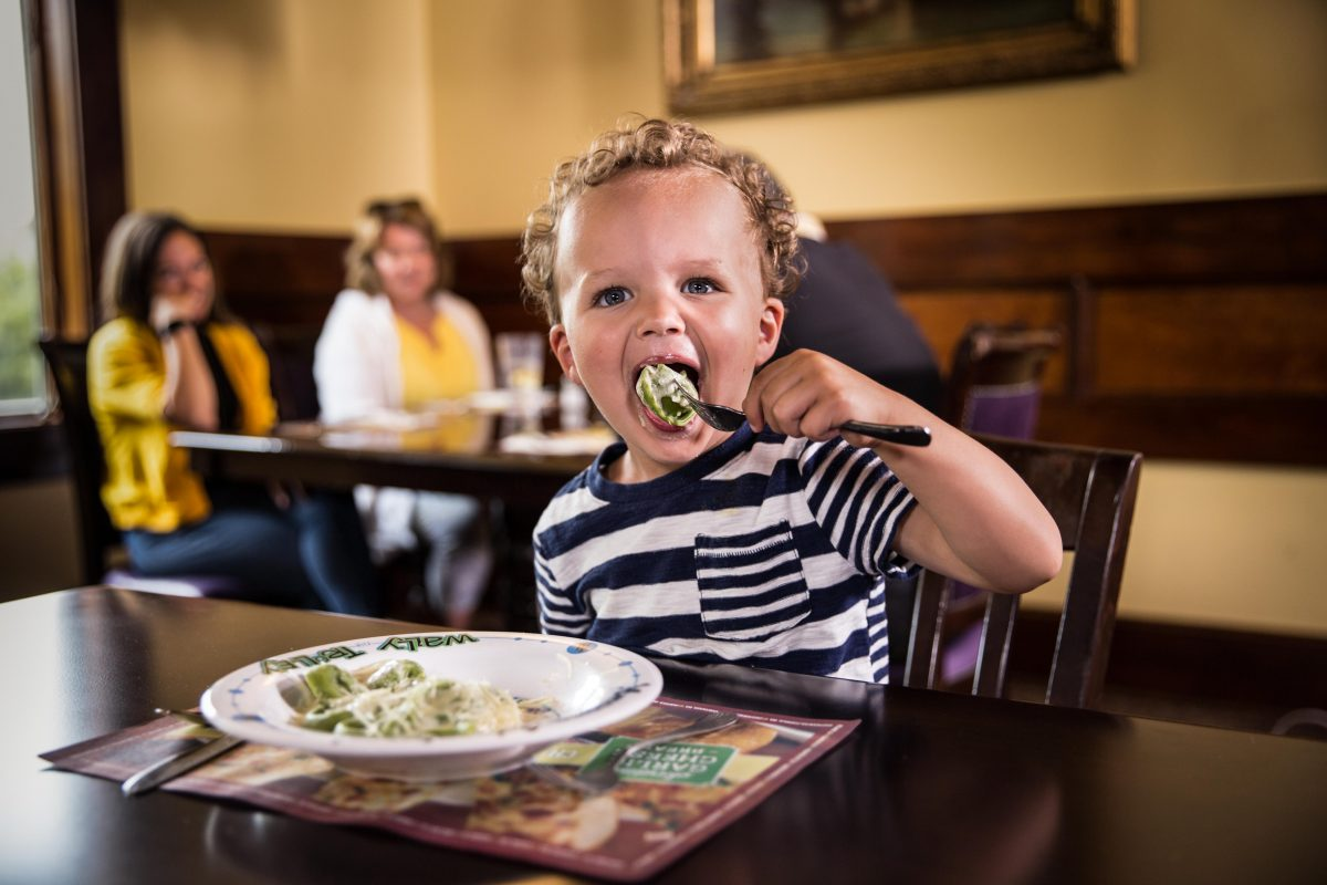 child eating pasta at The Old Spaghetti Factory