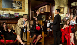 Cast of Murder Mystery Company show posing in costume